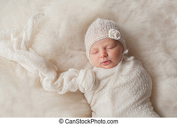 Newborn Baby Girl Wearing a White Knitted Bonnet - A...