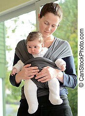 Newborn Baby in a Baby Sling Wrap