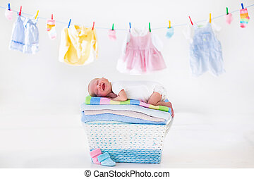 Newborn baby in a basket with towels - Newborn baby on a...