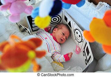 Newborn baby in a cot