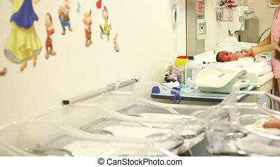 newborn baby in a newborn care unit