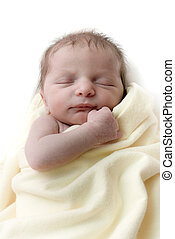 Newborn baby in a yellow sheet