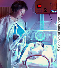 newborn baby in incubator box, phototherapy