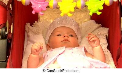 newborn baby in pram