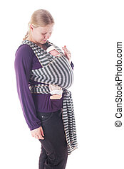 Newborn baby in sling - Mother with newborn baby in sling...