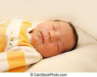Newborn baby, infant, sleeping in it's bed