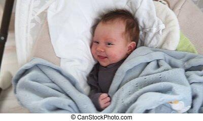 newborn baby lies in cradle - Happy newborn baby lies in...