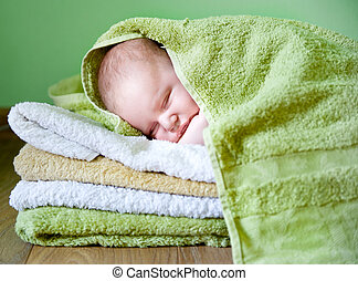 newborn baby on a towels