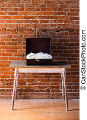 Antique box with a white blanket ready for a newborn baby during a child photo shoot.