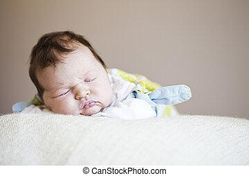 Newborn baby - Portrait of a cute newborn baby girl sleeping