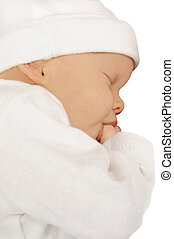 Newborn baby sucking on her thumb