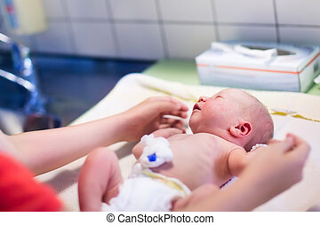 Newborn baby washed after birth - Newborn child washed and...
