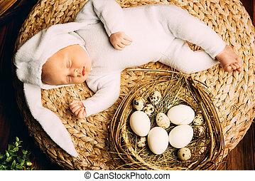 newborn baby with basket