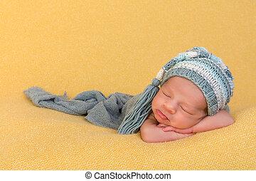 Newborn baby with blue bonnet