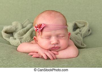 Newborn baby with headband