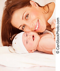 Newborn baby with mommy - Closeup portrait of sweet newborn ...
