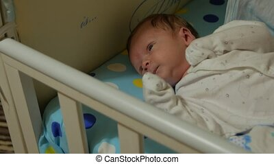 Newborn Baby Yawning - The newborn baby boy one month old is...