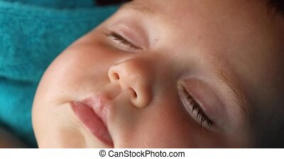 Newborn child is sleeping close up - Newborn child is...