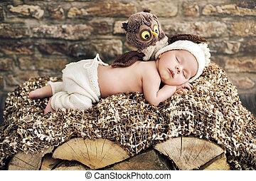 Newborn child sleeping on the wooden bed