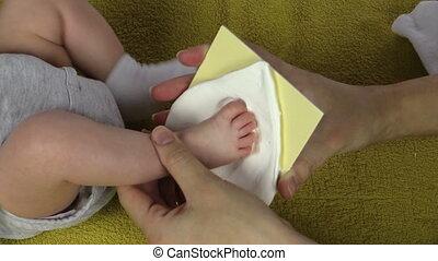 newborn footmark make - Closeup of mother hands create...