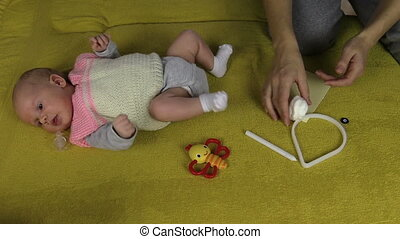 newborn footprint make - Newborn baby lie on sofa and mother...
