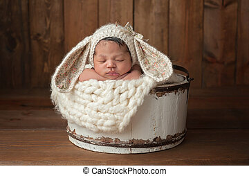 Newborn Girl Wearing a Bunny Bonnet - A three week old...