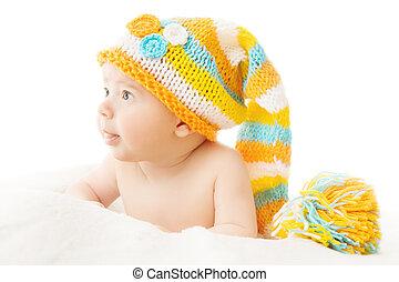 Newborn hat baby portrait in woolen cap over white...