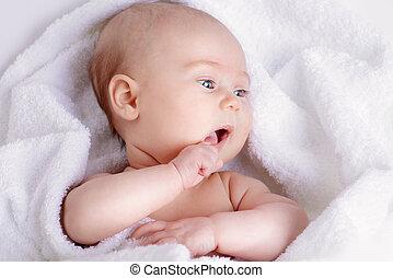 newborn in white towel