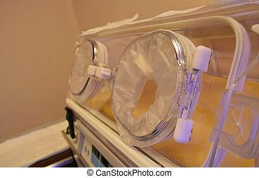 newborn incubator closeup on doors in hospital room