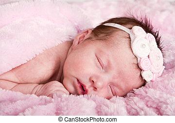 newborn infant sleeping - Newborn infant girl sleeping on a...