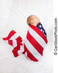 Newborn infant wrapped in USA nation American flag