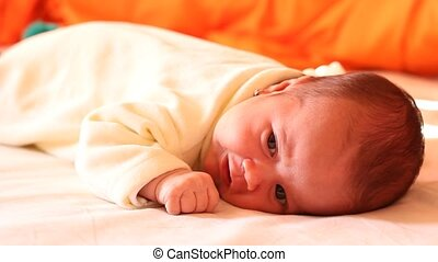 Newborn Laying in Bed