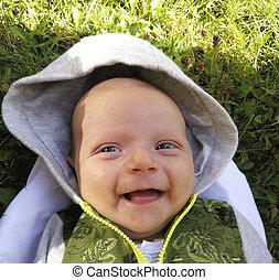 Newborn male child in summer