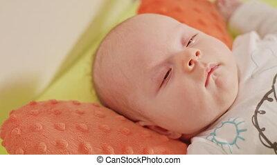 Newborn Sleeping Baby in Bed Close Up