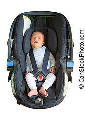 Newborn sleeping in car seat