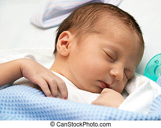 Newborn - Sleeping baby on his first day
