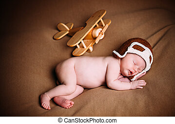 newborn with airplane