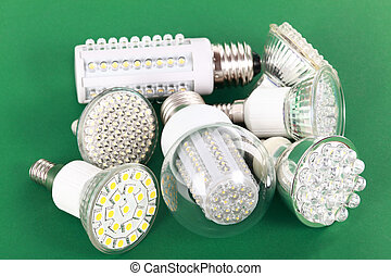 Newest LED light bulb on green background