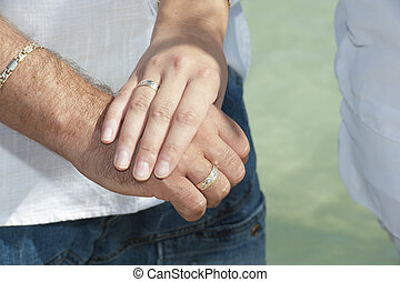 Newly engaged couple showing off their rings