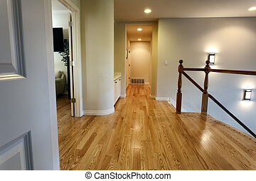Newly installed oak floor boards for hallway in home