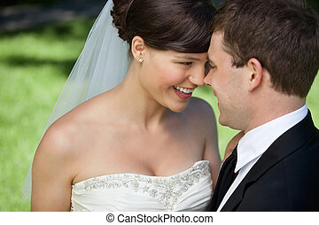Newly Married Couple - Newly married couple looking at each...