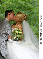 Newly-married couple - Recently married pair has kissed in...