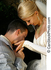 Newly-married couple - The groom kisses palms to the bride