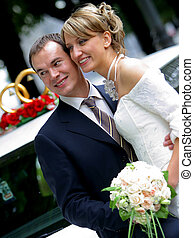 Newly Married Couple - A portrait of a handsome groom sat on...