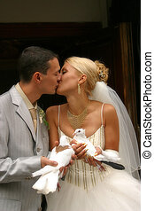 The groom and the bride with white pigeons