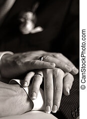 Newly-married couple - The groom keep the bride for hands. b...