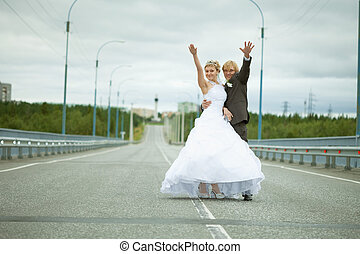 Newly married have fun on highway - Newly married have fun...