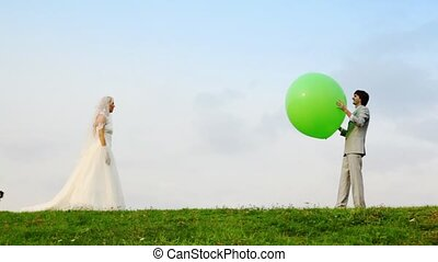 Newly married play meadow with each other inflatable sphere...