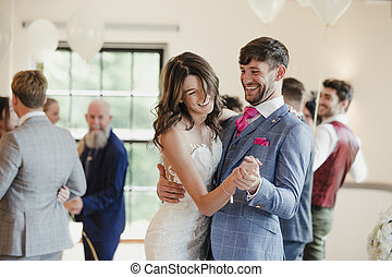Newly Wed Couple Dancing With Their Guests