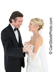 Newly wed couple holding hands whil - Happy newly wed couple...